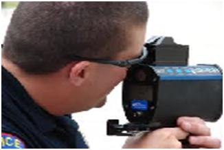 A LIDAR gun at the hands of a traffic policeman